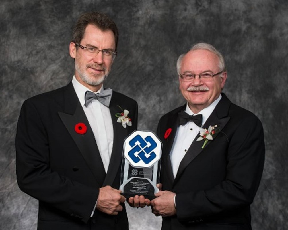Dr. N. Kneteman and Dr. L. Tyrrell receiving ASTech Foundation Award